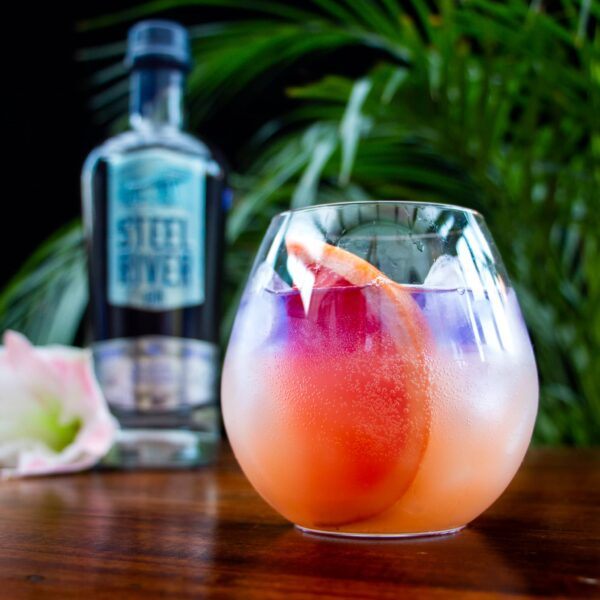 Stainsby Girl Gin Cocktail using Grapefruit Juice in a tumbler glass with grapefruit to garnish