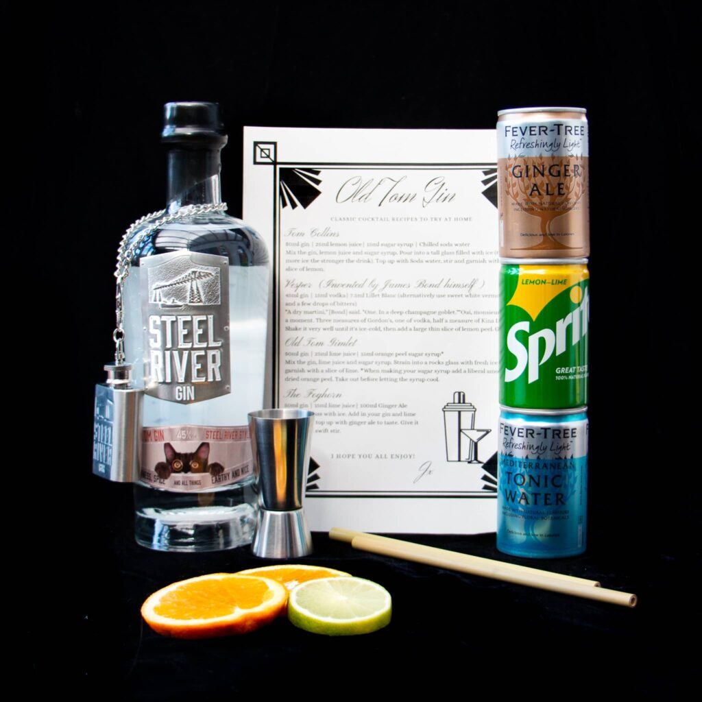 Steel River Old Tom Gin 70cl Bottle; three 150ml mixer cans with lemonade, tonic and ginger ale; Steel River Jigger, straws, garnishes and an Old Tom Gin cocktail list